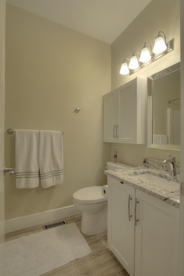 The en suite bathroom has a full vanity, two medicine cabinets plus a tub for relaxing in.