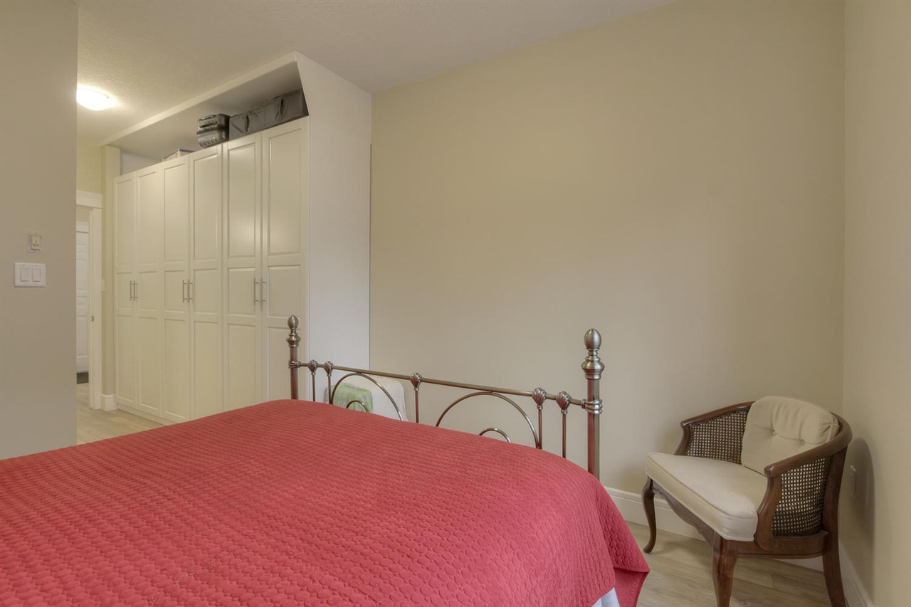 The master bedroom is entered from the main hallway but you will pass through the wall of closets.