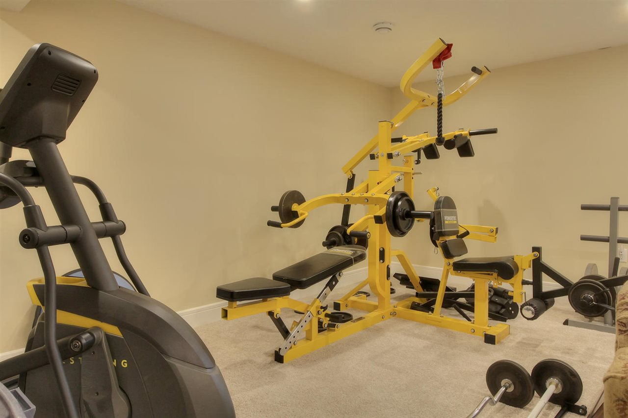 Check out the gym equipment that fits into the basement family room.