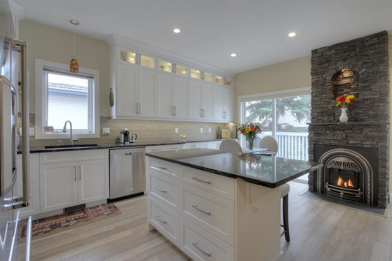 This unique fireplace is the focal point from the kitchen or the living area. Note all the cabinets and the layout has been designed to be open, functional and beautiful,