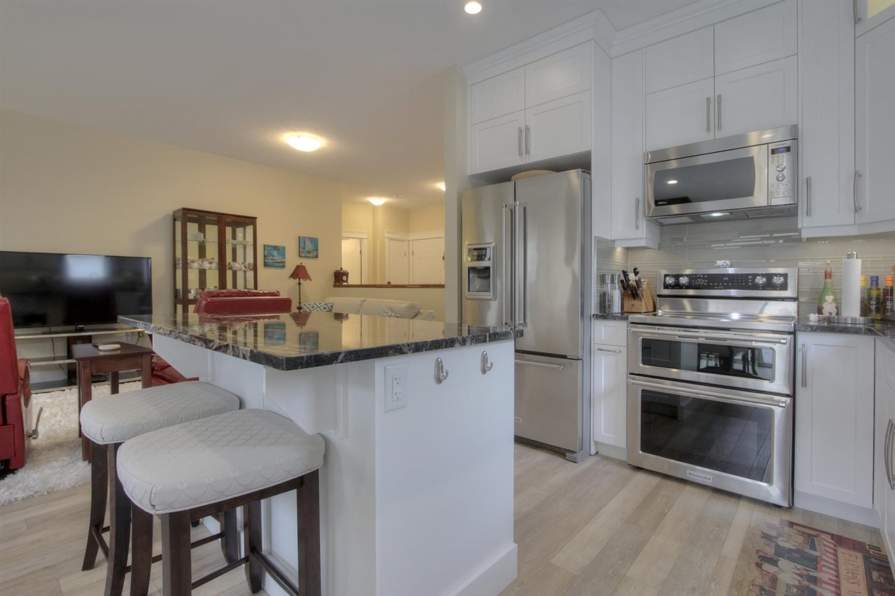 Imagine cooking in this updated kitchen. What more could you need than good design, high end appliances and a plethora of cabinetry.