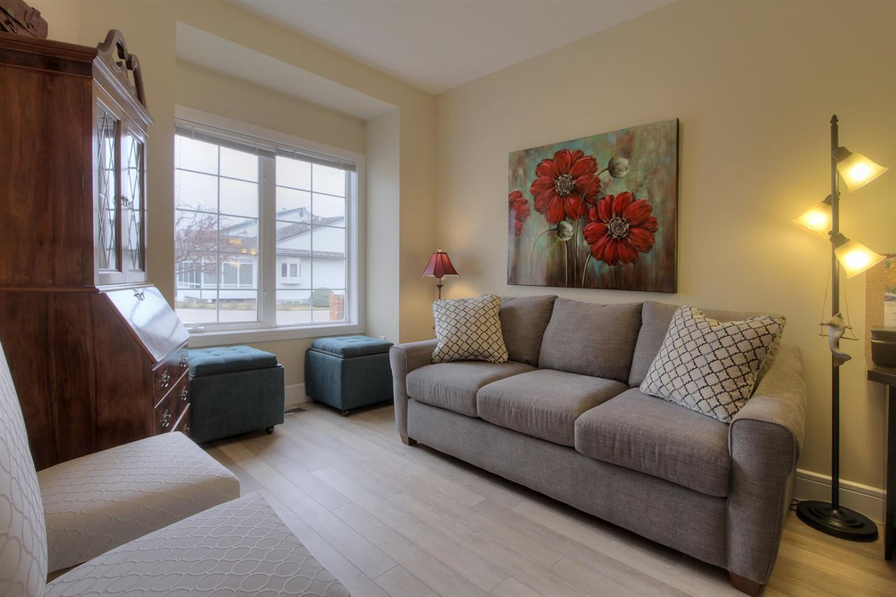 There is a second bedroom at the front of the main floor. This makes a great combination den/guest room with the sofa bed. There is a built in desk and a closet behind the door.