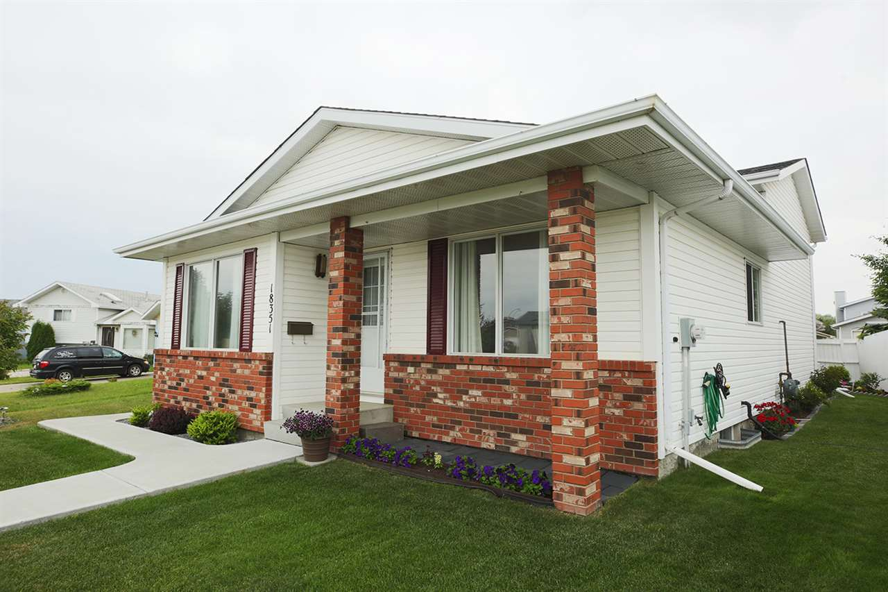 Spotless 4 bdrm, 3 bath home with over-sized, double-detached garage in lovely Lymburn! Pride of ownership is evident in this beautiful family home. The main level features entry, a spacious living room, large dining room & kitchen w/ sleek granite counter-tops. Upstairs, 3 bdrms & 2 full bathrooms (...the master bdrm has 3 pc ensuite w/ shower) ... and both bathrooms have upgraded marble counter-tops! Downstairs, another full bathroom, a huge second living room space with cozy gas fireplace. The lower 4th level is partly finished and awaits your personal touch! NEW ROOF, NEW H20 TANK, NEW FURNACE, & NEW WASHER & DRYER ('11). The lot features a HUGE front yard, NEW SIDEWALKS, over-sized double garage, flower garden and quaint backyard.