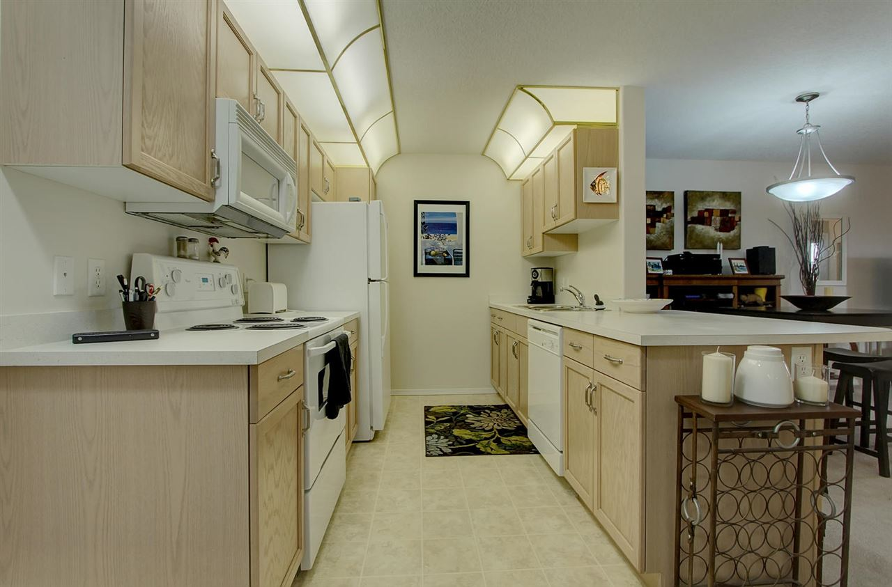 This galley style kitchen is well organized and has plenty of storage and counter space.