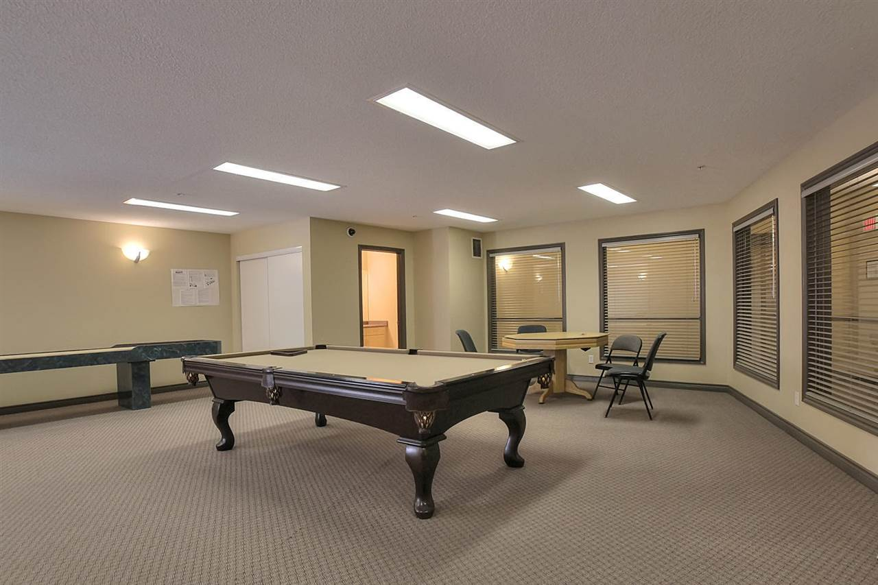 The games room on the 4th floor has a pool table, shuffleboard, poker table and even a dart board.