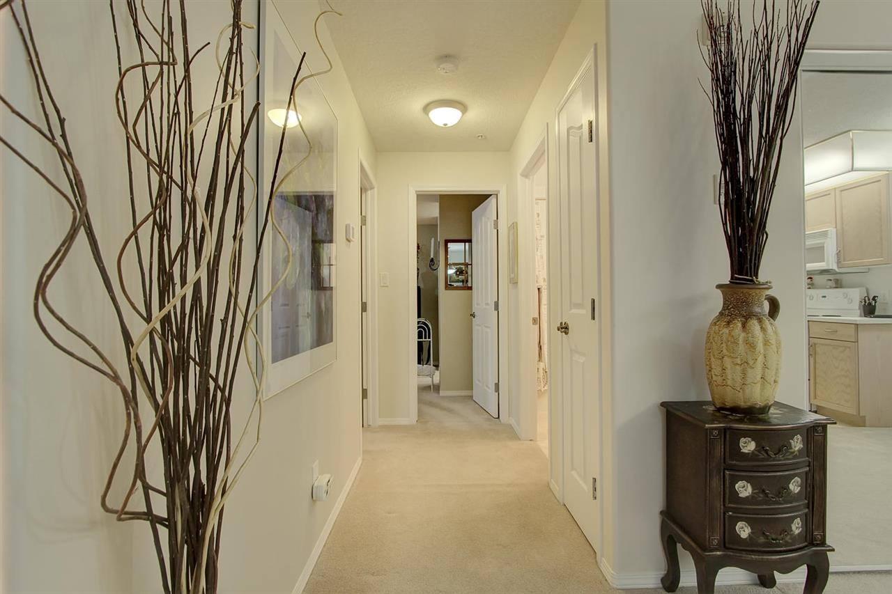 There is a hallway leading to the two bedrooms and the two bathrooms.
