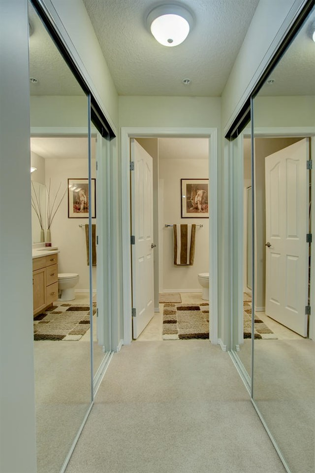 The two closets in the Master bedroom each have mirror doors and make a walk through into the Master En suite bathroom. .
