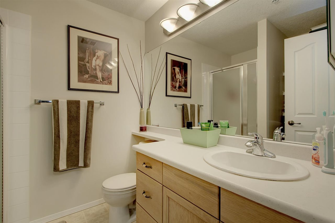 The Master en suite bathroom has a handy shower stall, a large vanity with banjo counter tops and ample storage behind the door for towels  plus a medicine cabinet.
