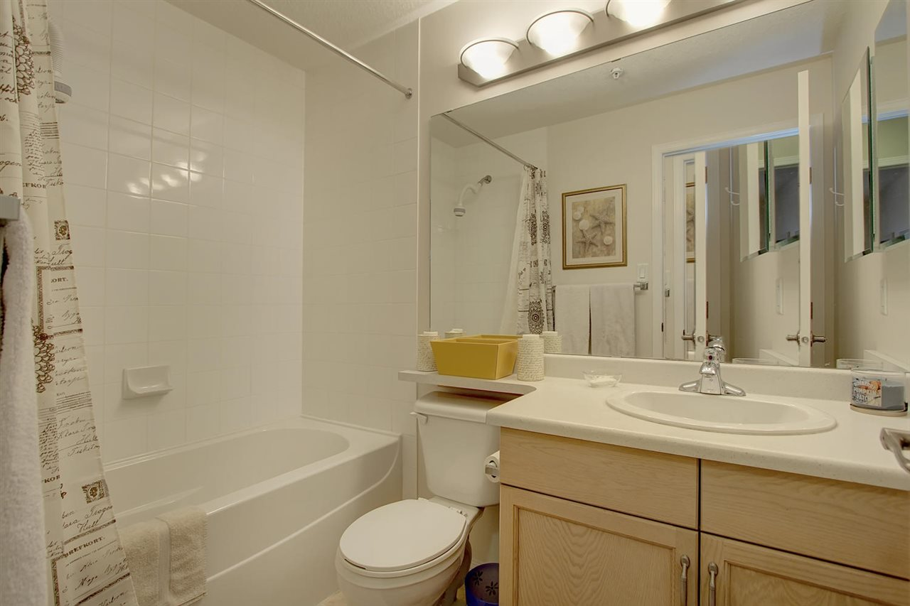 The main bathroom has a deep soaker tub. This bathroom is across from the second bedroom. This private location is tucked away from the living rooms.
