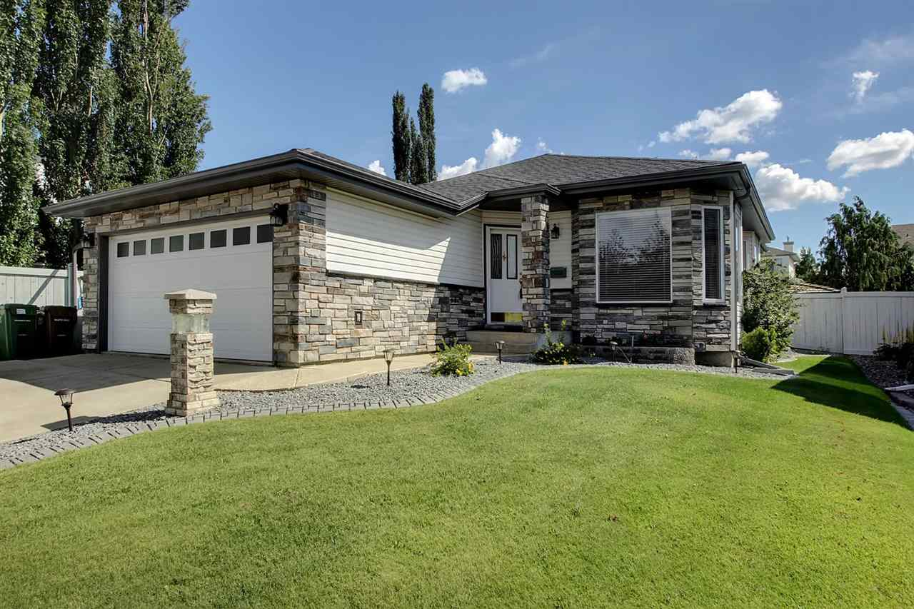 This 1400 + ft 2 bungalow offers two main floor bedrooms plus a den. The large Master bedroom has an expansive walk in closet plus a three piece en suite bath. The formal dining room is a good space for entertaining. The kitchen is adjacent to both the dining area and the large living room.  The back yard enters off the kitchen and has a large deck, nice landscaping and the fire pit plus benches will remain with the home. Downstairs is a 3rd bedroom, large rec room complete with bar (bar fridge and wine cooler will stay) and a full sized pool table that will also stay. The 3 piece bathroom makes the basement handy and the large storage/workshop/laundry area may have a lower ceiling but makes up for it in functionality. The list of substantial renovations in recent years include exterior stone front, new shingles, soffits and fascia, new garage door, new furnace, hot water tank and central air conditioning, gas insert in fireplace, some windows and new blinds. The heated, spacious garage is a great bonus.