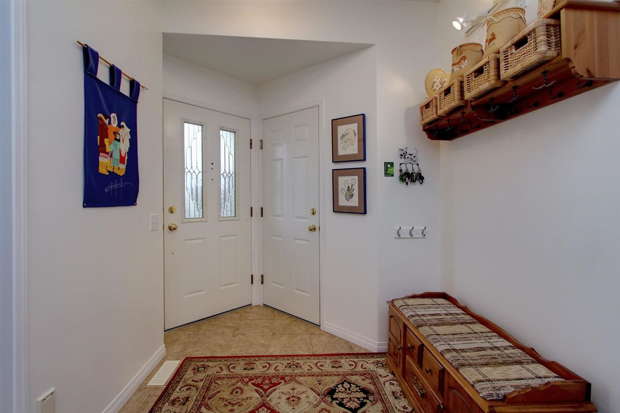 The entry to the home is quite spacious. Even with the door to the garage here, there is room to enter easily.