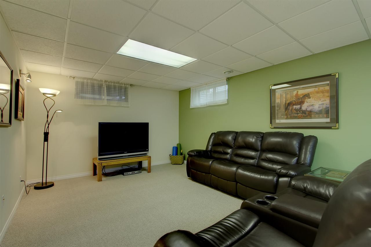 The family room space in the adjoined basement development has two windows, good lighting and brand new carpeting. There will be many a movie night in this space.