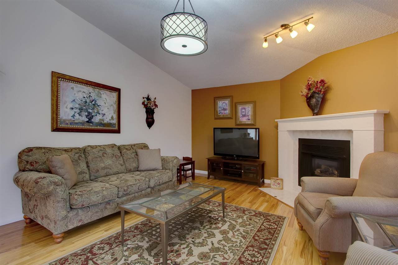 The living room on the main floor also has hardwood floors, the fireplace has a gas insert for ease of use. The home is also air conditioned.