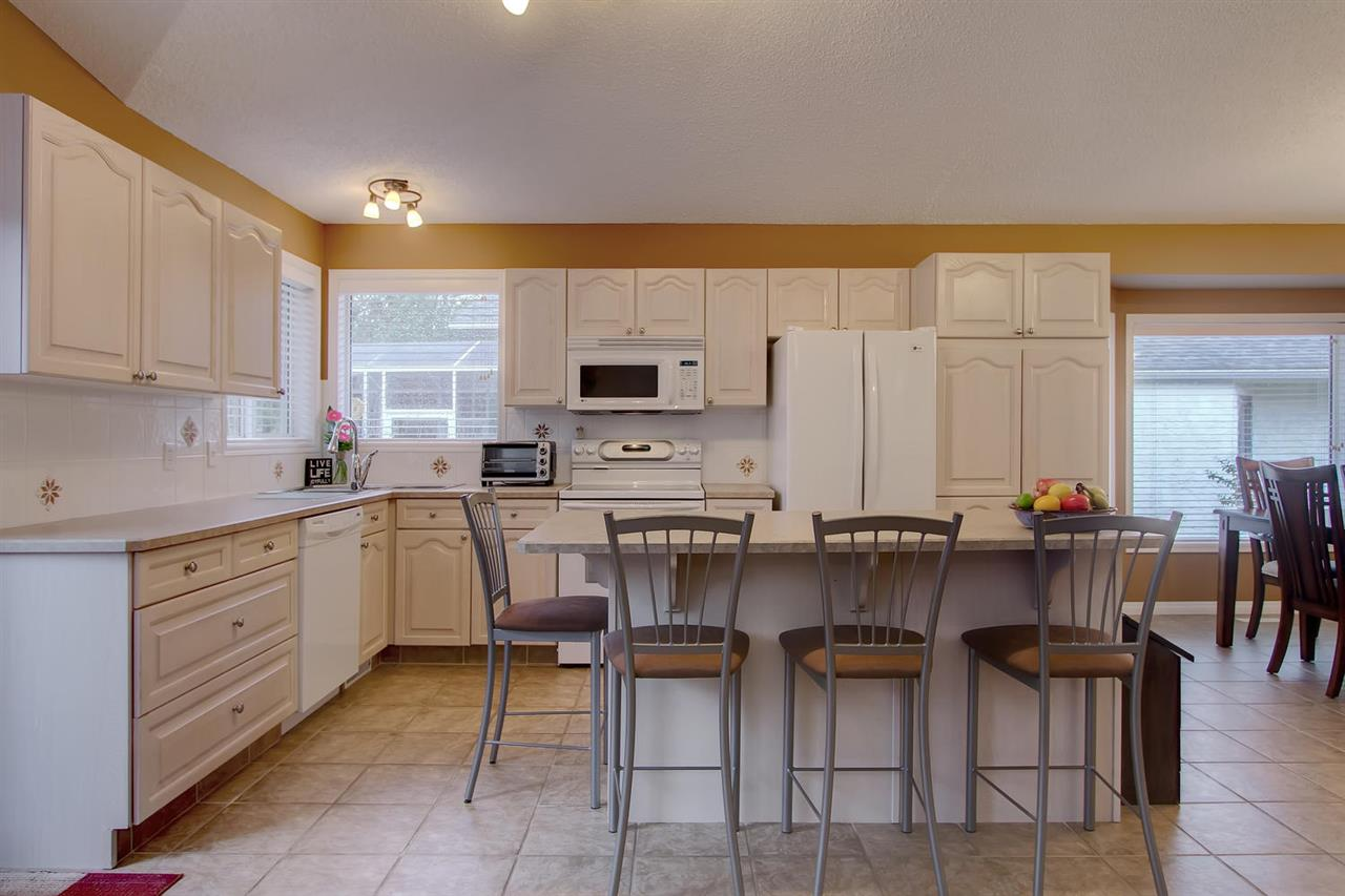 This kitchen is great for quick meals or snacks as there is plenty of space at the island.