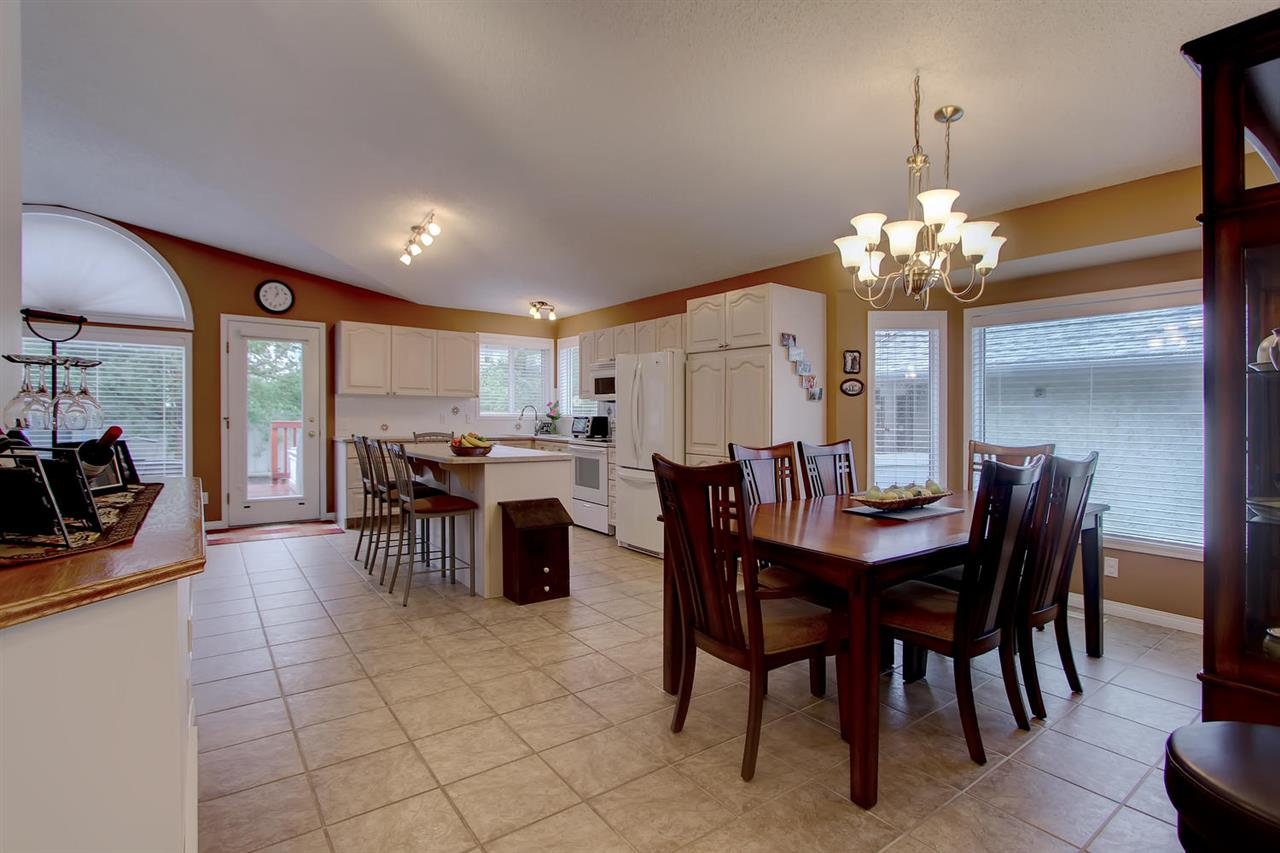 You can see how the room flows from kitchen to dining room which makes it easy to serve meals and do a quick clean up. Note the light and how it flows. The large dining room was just replaced.