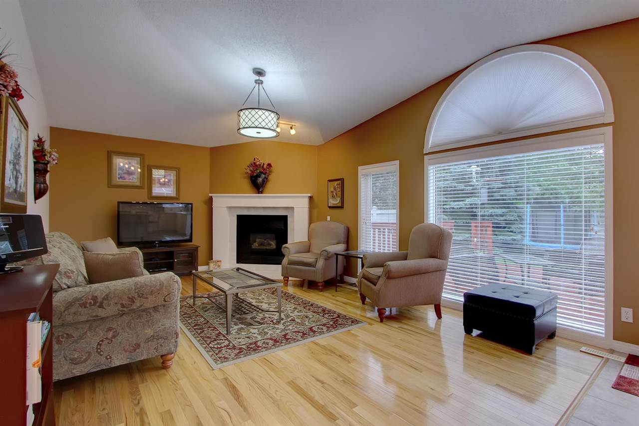 What a great flow of light comes into the living room and it highlights the hardwood flooring also.