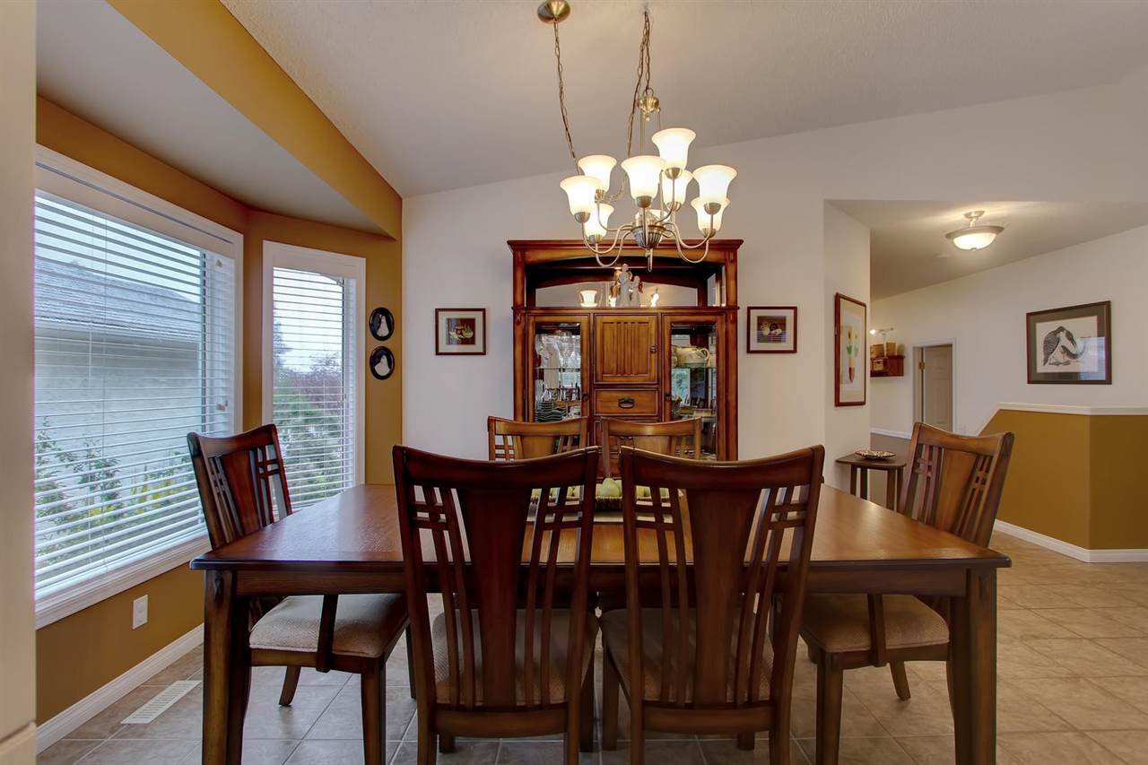 The dining room easily holds a large dining room suite.