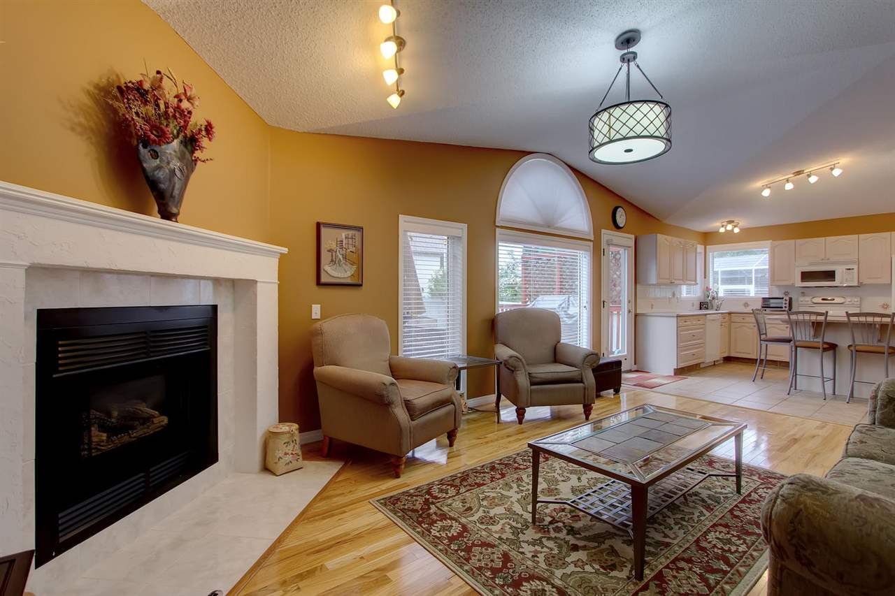The large open living space includes a generous living room, spacious kitchen with island seating, and dining room.