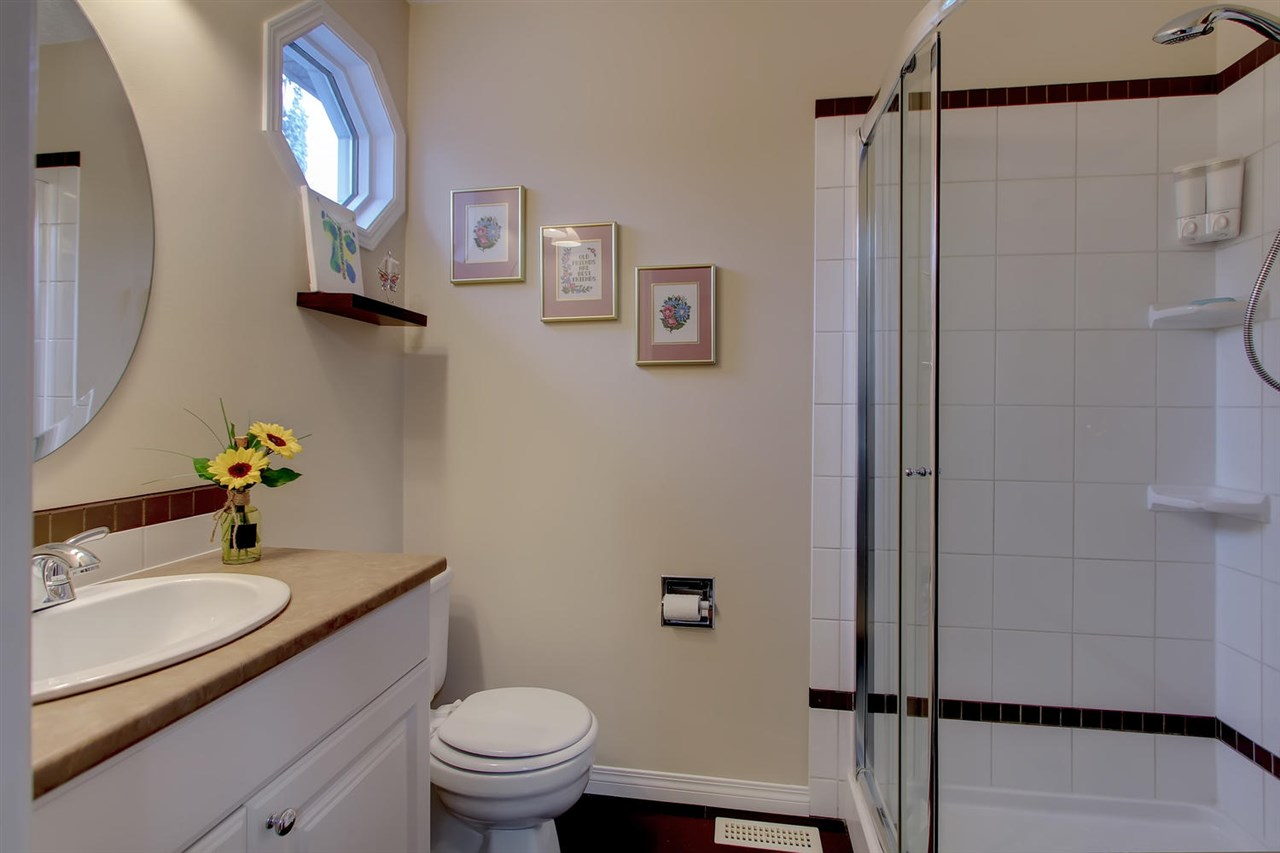 The Master en suite bathroom has a shower and plenty of storage for morning rush hour.