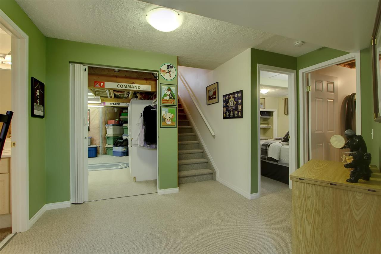 The basement has no long hall. All areas enter off the main entrance at the bottom of the stairs.