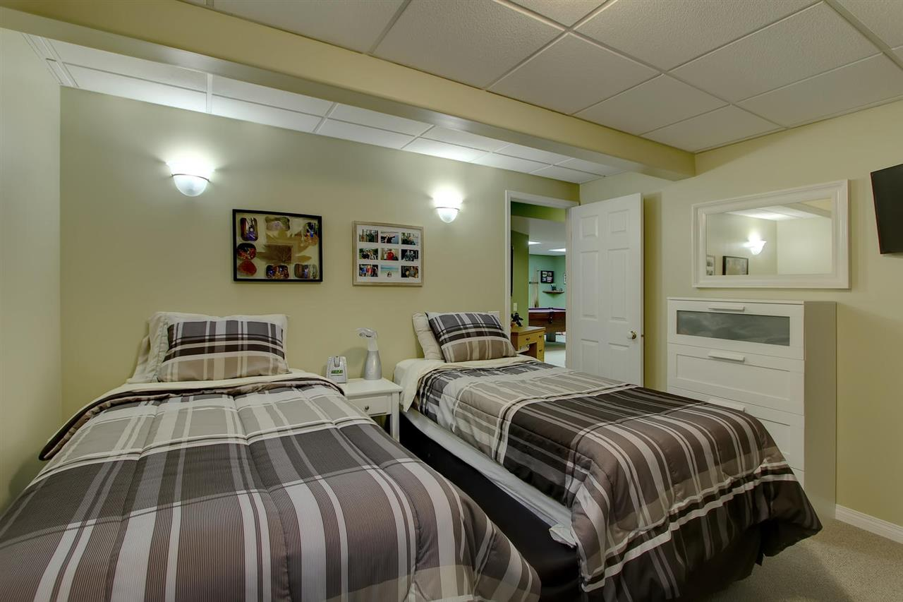 The large bedroom in the basement would make a great spot for an older child, guests or even a live in nanny.