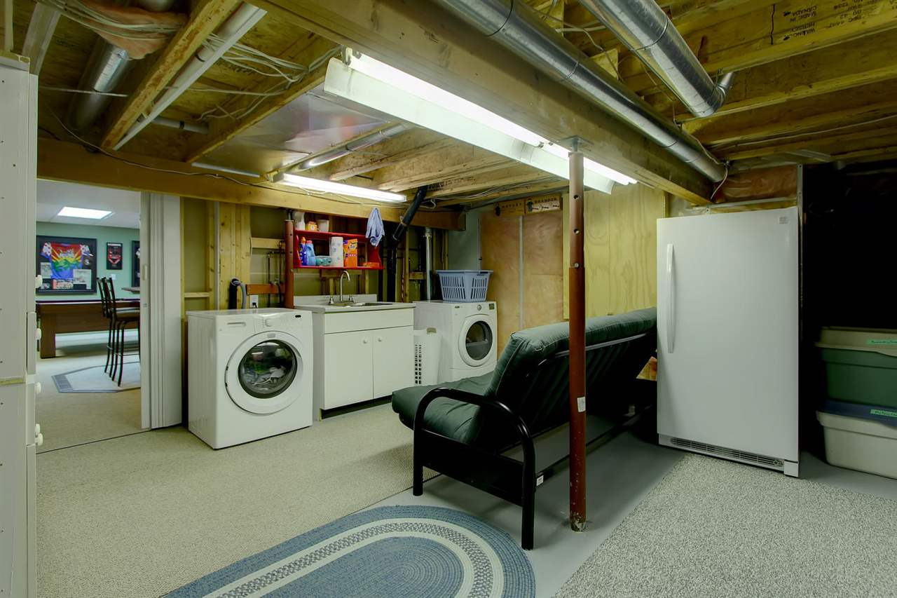 There is a large space in the basement that is just a bit shorter in height. This has made a great laundry area and there is also a lot of storage space here. If you are tall, you may have to duck a bit... but many have no problem standing up.