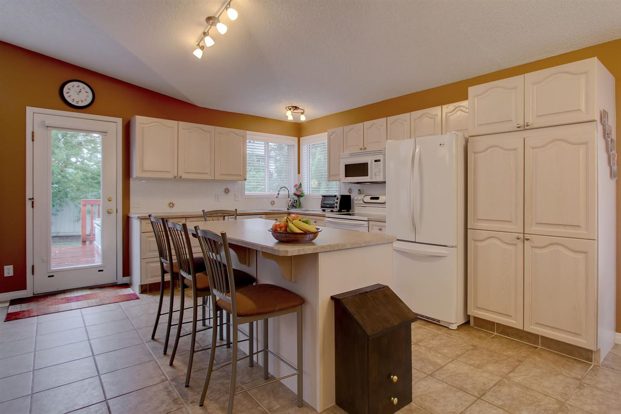 This kitchen is well lit with the corner windows over the corner sink. Plenty of cabinets plus pantry will make storage plentiful. There is also a walk in pantry/cupboard nearby.