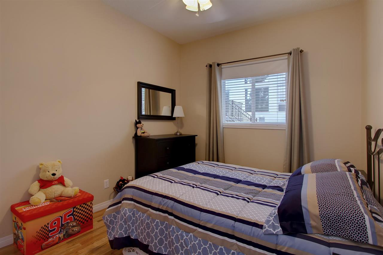 The second bedroom in this bungalow also has hardwood flooring and is adjacent to the main floor den.
