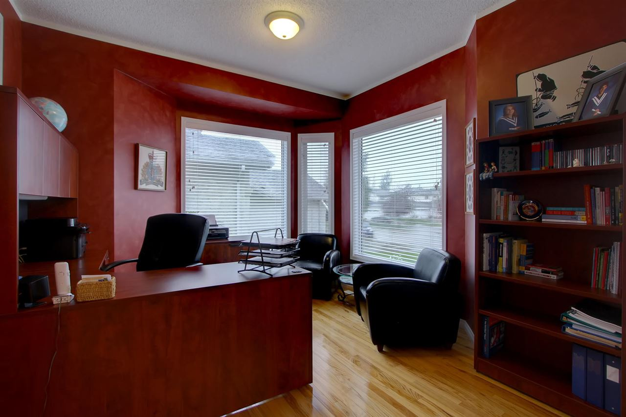 This den has great natural sunlight from the large windows. It is located near the front door so would make a wonderful home business office.