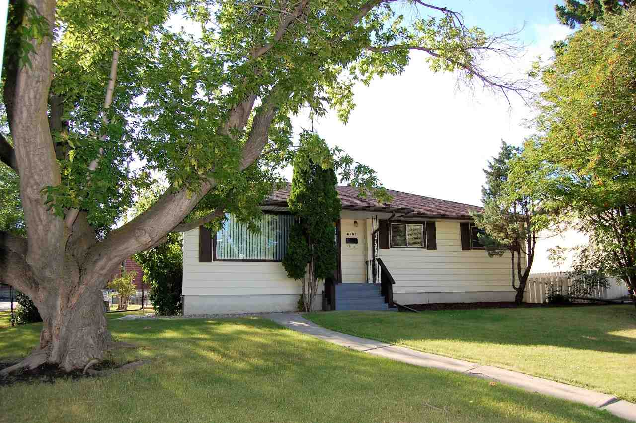LEGAL SUITE!!!  Here is your chance to SUPPLEMENT those mortgage payments with YOUR own LEGAL SUITE!!!!  This  3+1 bedroom bungalow has gorgeous NEW HARDWOOD floors throughout the main floor & NEW CERAMIC TILE in kitchen & front entry.  The RENOVATED main bath has engineered GRANITE Countertops, STUNNING PORCELAIN TILE flooring & bath tub area, NEW toilet, NEW soaker tub & paint. Three bedrooms on the main.  NEW 40 yrs ROOF SHINGLES in 2016.  Easy maintenance vinyl exterior with capped windows.  Newer chain link fence, large yard with a BEAUTIFUL TREE in the front yard--perfect for climbing!  The basement requires some flooring & ceiling to complete.  The one bedroom suite could easily be enlarged to incorporate the basement living room or can be left as is allowing the main floor to use the space.  Lots of opportunities here!!