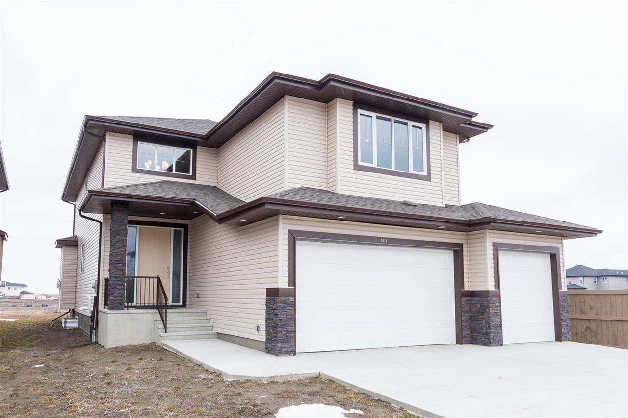 Beautiful brand new 2785 sq. ft. 2-storey in Eaglemont siding greenspace with west facing back yard.  Unbeatable price with a triple garage (31?x26? & 24?), 4 bedrooms, bonus room, two 4 pc baths, 5 pc ensuite with its? own bathroom. The exquisite detailing and layout of this home is flawless. You are greeted with a soaring ceiling in the foyer with built-in shelving, a huge front closet with stunning porcelain tile & hardwood flooring throughout. Great open concept features the living room with a gas fireplace, kitchen with plenty of dark cabinets, quartz countertops, island w/eating bar, spacious dining area with a garden door. The walk through pantry, main floor laundry with walk-in closet, 4 pc bath and main floor den complete this level. The staircase to the upper level begins with the huge bonus room, 3 bedrooms, 4 pc bath and paired doors to the master?s quarters. The master bedroom is enormous with a walk-in closet, luxurious master bath with oversized shower, dual sinks & Jacuzzi spa tub retreat.