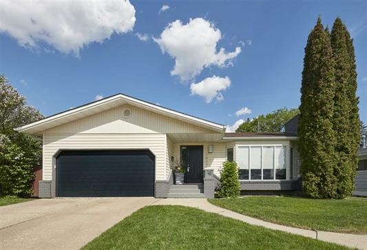 Incredible Valleyview location, just steps to the river valley & parks! This 3 beds plus dens (windows in each room) in the basement, 3 baths, 1773sqft - stunning bungalow has been renovated to a modern open-concept on the main floor - double attached garage all located on a large 7258sqft lot! Entering the home you will love the hardwood throughout the main level. The formal living room with wood fireplace is open to the formal dining room. Step into the fabulous modern kitchen with skylight, quartz counter tops, ample storage & a 2nd dining area. Open from the kitchen is the family room with gas fireplace! Down the hallway you will find the spacious master bed with 3 piece ensuite, 2 beds & a 5 piece bath completes the main floor. The fully finished basement is perfect for family movie nights with a wood burning fireplace, games area, 2 dens, laundry, storage & AC. Outside large deck & yard complete this amazing home!  Close to all amenities & the location offers terrific access to downtown & the UofA.