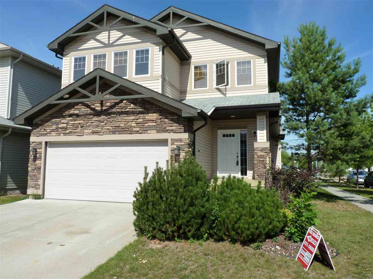 Check out the amazing value in this former show-home with built-ins galore PLUS a fully finished basement! You know it was finished well to demonstrate the builder's quality of workmanship. An open flowing floor plan makes this home feel even larger than the 2150 sq ft it shows on paper. With 3+1 bedrooms, den, and 2.5 baths (plus a basement full bath rough-in) there is room for everyone in the family to have their own space. The master bedroom features a luxurious ensuite (corner bath and HUGE shower) with a generous walk-in closet making it the perfect private retreat. Copious counter & cabinet space are complemented by the walk-through pantry which accesses the garage entry mudroom and main floor laundry. The eating bar style island and a dedicated dining area will serve all your food serving needs.  The newly refinished deck is right off the dining area & has a natural gas connection. A built-in whole home speaker system, central air conditioning, plus a gas fireplace round out this package nicely.
