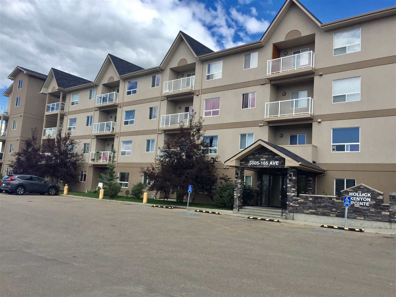 This 2nd Floor South Facing unit has 2 BDRMS. + 2 BATHS + 2 PARKING STALLS (1 assigned & 1 titled).  Just over 800 Sq. Ft. and featuring insuite laundry, a large kitchen and living room with brand new laminate flooring.  The master bedroom has brand new carpet and paint and features a large walk-in closet and 4 piece ensuite.  The second bedroom and 4 piece guest bath is conveniently separated by the living room for added privacy.  Glass railing balcony is just off the living room and looks out on a treed walking path.  Building has plenty of visitor parking as well as exercise and social/party room.  Many walkable amenities very close by incl.; banks, grocery, restaurants etc.  5 min. drive to Henday or Clareview LRT station.
