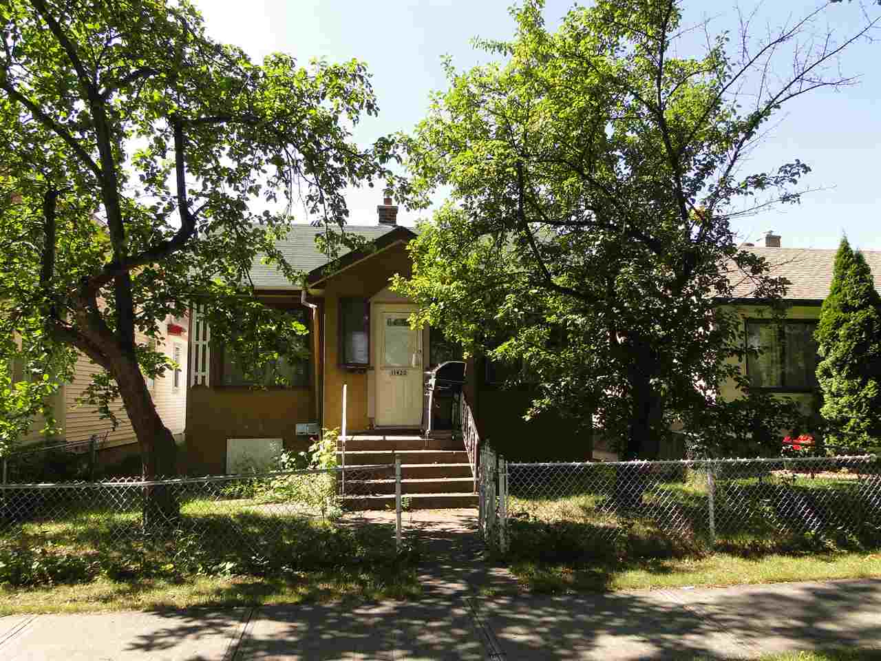"""A project with a great start!.. This 1036 sq.ft. 3 bedroom Bungalow located in the Parkdale community is in the process of being renovated, the exterior walls have been upgrade to 2""""x6"""", new drywall, old flooring mostly removed and ready for flooring of your choice, some newer windows and a 328 sq.ft. addition with crawl space. The main floor has three bedrooms, a great start to the 4 piece bath, living room, dining room, small open den, main floor laundry room. There is a separate entrance to an open unfinished basement under the original dwelling, a previous suite was removed. The exterior is currently a variety of stucco, vinyl and waiting to be completed. A great start to a beautiful home, or an investment property. The appliances currently in the property do not stay."""