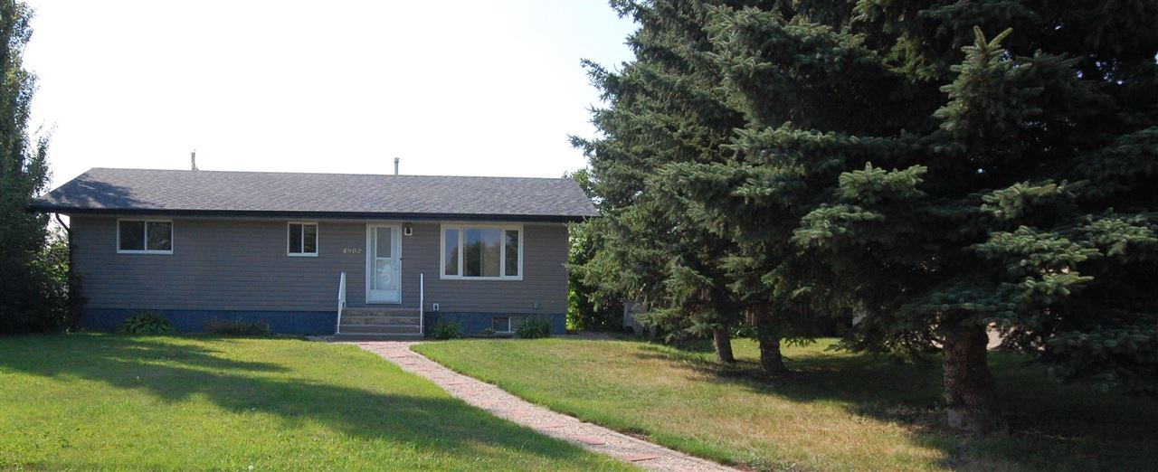 Perfect starter home on a quiet street in Millet. This 3 +1 bedroom, 2 bathroom bungalow has loads of updating which include, shingles, vinyl siding( house ,garage & shed), hotwater tank, high eff furnace & deck. The kitchen has been updated a few years ago with new appliances, cabinets & countertops. Kitchen also features a large walk in pantry. Nice size living room, a 4pc bath & 3 bedrooms completes this level. Large back entry as well. Basement is partly finished with another bedroom & 3 pce bath, only some ceiling & floors to complete the rest. Large deck off the back entrance, storage shed & 24' x 24' garage with a back lane.
