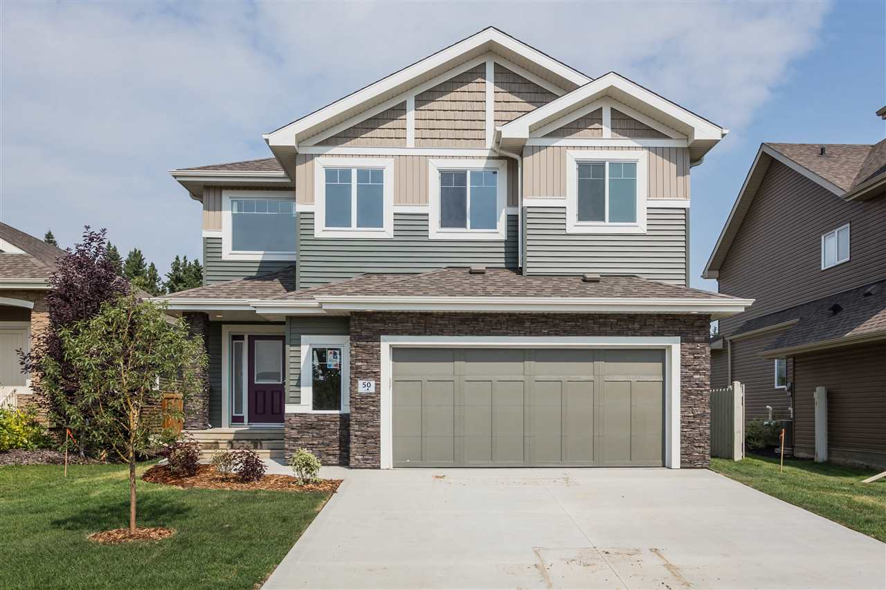 SPECTACULAR NEW BUILT BI-LEVEL LOCATED IN ERIN RIDGE NORTH! Gorgeous interior with a stunning kitchen featuring granite, maple cabinets, island with an open concept complimenting your dining area with garden door to your fully landscaped yard, 12x15 maintenance free vinyl deck with aluminum railing, all weather wood steps to grade, backing onto a quiet green space. Enjoy family time by the fireplace in your cozy living room -with engineered oak hardwood. Finishing off your main floor are 2 spacious bedrooms. 4 piece bath and a walk- in laundry room.  Master bedroom is located on the upper level with your own privacy, 4 piece ensuite and walk in closet. Fully finished basement boasts a huge family area with an office/den, entertainment bar & a 2 piece bathroom. 9? ceiling on main floor & basement! Fully landscaped yard with fence, deck &  O/S Double garage complete this fantastic new built dream home. Move in today, completely finished & built with exceptional quality! Over 2600 sq ft of living space.