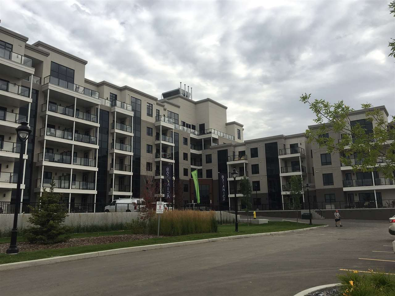 NOW EVEN A BETTER DEAL! This ONE BEDROOM PLUS DEN unit in THE BOTANICA  has the most exclusive address in St. Albert.  Adjacent to THE SHOPS AT BOUDREAU , you will find restaurants,  shops and varied services. This high end steel and concrete building offers sound proof living with enhanced  fire safety. The open floor plan from entrance, through kitchen, dining and living rooms are modern with extras to appreciate. The master bedroom has a spacious walk in closet plus 5 piece en suite bathroom including double sinks and deep soaker tub and large shower with quality glass doors. Cambria quartz countertops highlight both baths and kitchen.The highest quality  is  standard throughout. The kitchen appliances are Bosch, plus a garburator and silgranit under mount sink , the back splash is full height and a great choice. The den leads into the powder room for nice privacy. The laundry room is spacious and your fan coil system is floor mounted. engineered hardwood, porcelain tile and 43 oz carpet in bedroom.