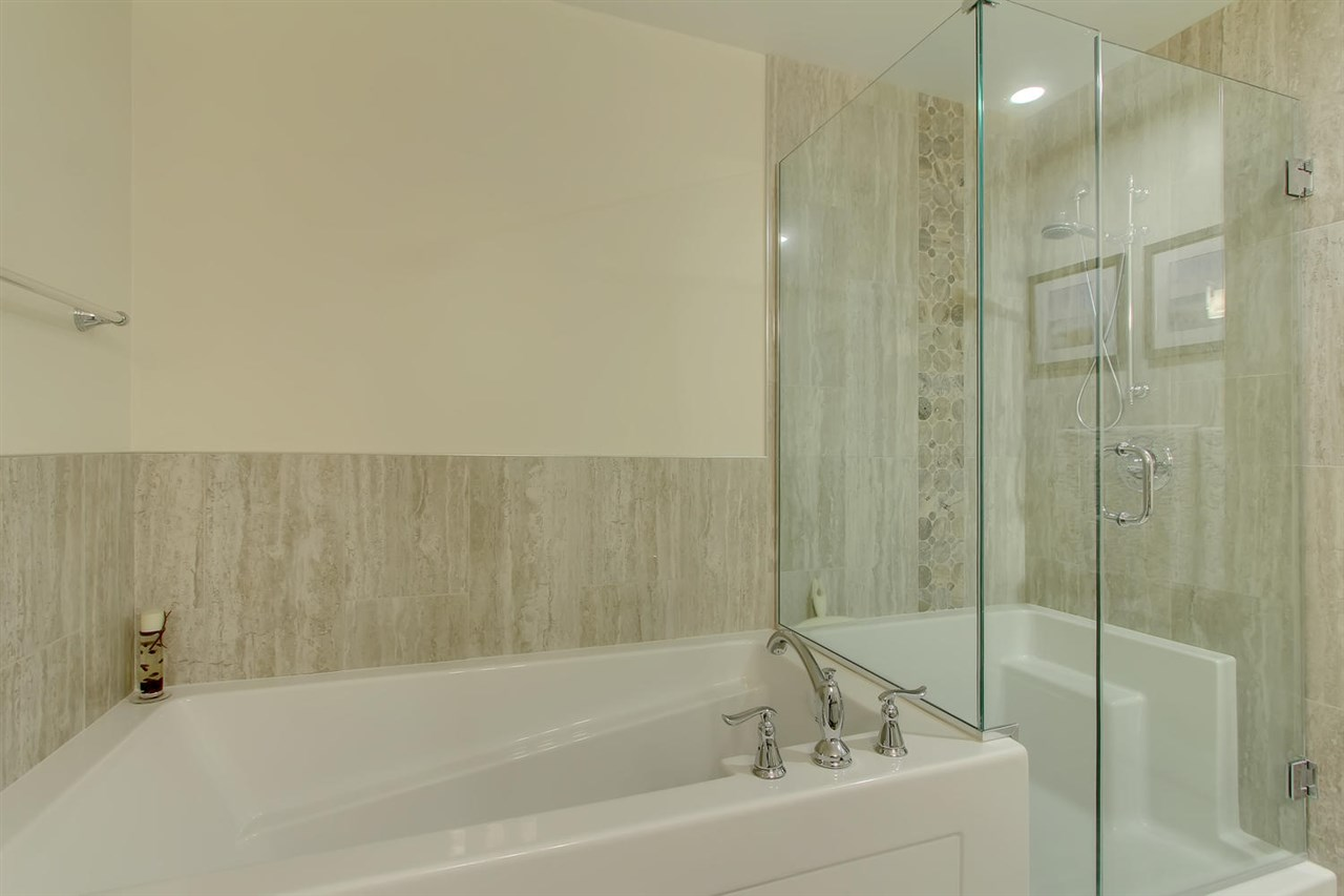 """This luxurious bath/shower combination says """"come and relax here"""". and you will. The spa like energy will keep you feeling pampered."""