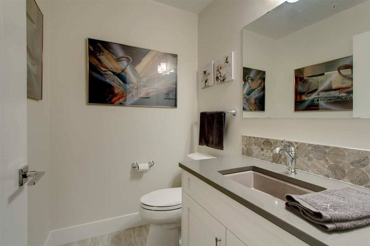 The half bathroom is accessed through the den. It makes the bathroom more private and it is also very nicely appointed.