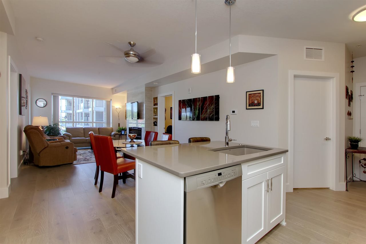 This is the view from the kitchen where you will be able to stay connected with your guests while you whip up something special to share with them.