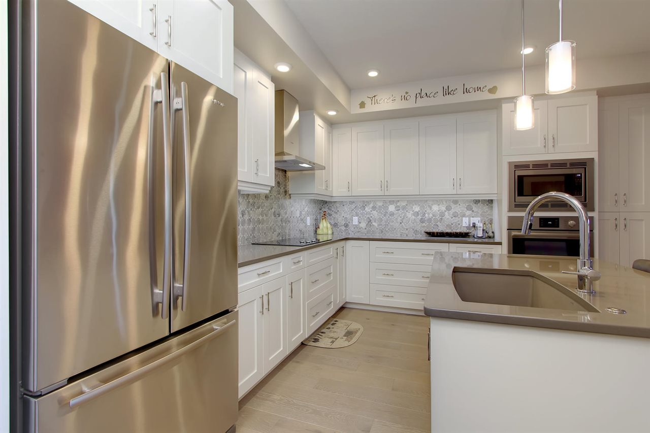 Well appointed is a good way to describe this kitchen. You will definitely enjoy the choice of cabinets, counter tops and appliances. No expense was spared to create the perfect kitchen for you.