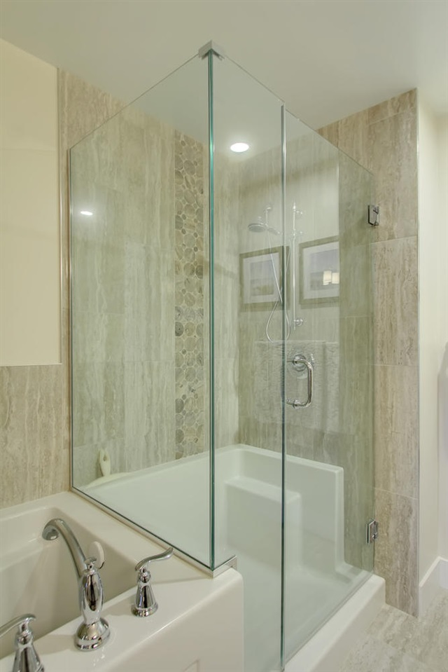 This glass enclosed shower is not only beautiful to look at, it is a good size too.