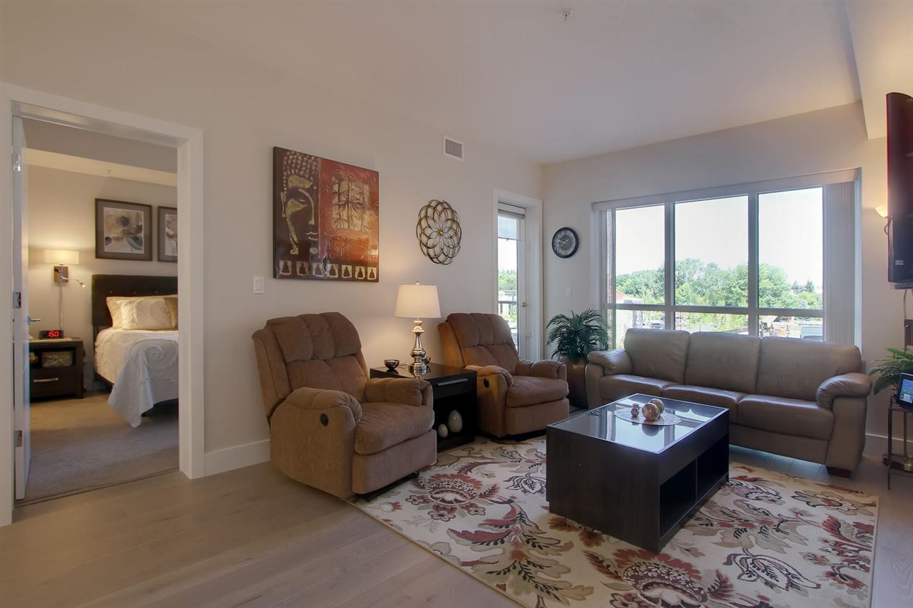 The comfortable living/dining/kitchen space is bright and open. The large windows and door to your balcony let the east facing sun help you enjoy your morning sun.