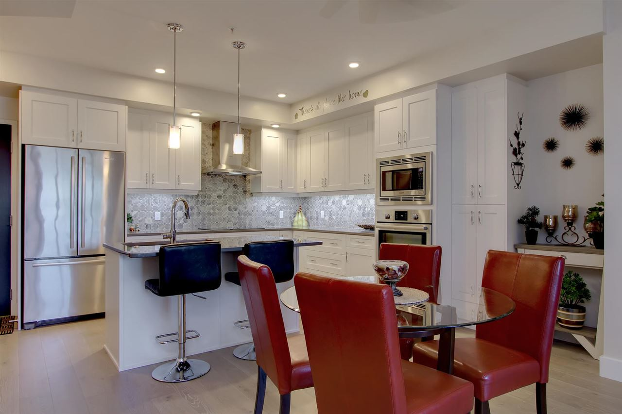 The dining space is perfectly spaced between the living room and kitchen.