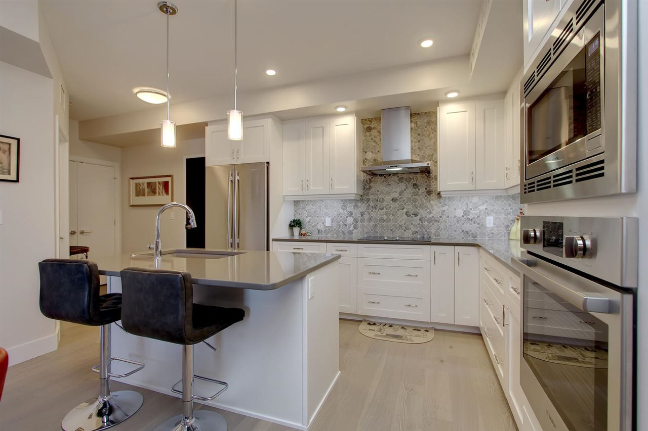WOW what a kitchen. This is totally upper end with quality throughout. The appliances, the counter tops, the back splash and to the ceiling cabinets all keep you feeling spoiled as you create wonderful meals.