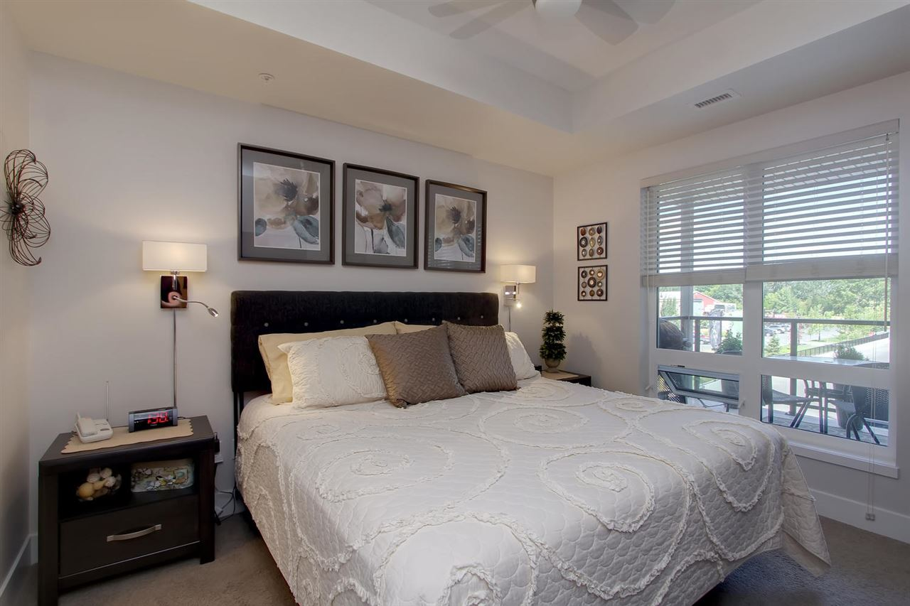 The Master bedroom enjoys early morning sunshine. There is space for a king sized bed and end tables. The cozy carpeting here will help  keep you warm on cold mornings.