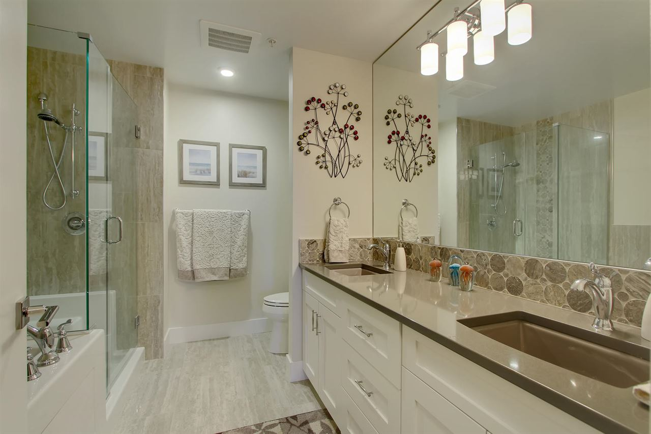 What an incredible en suite bathroom you will have to enjoy. Double sinks, a very generous sized soaker tub, attached glass enclosure shower and high end lighting and tile work will give you that luxury spa feeling. Enjoy it!