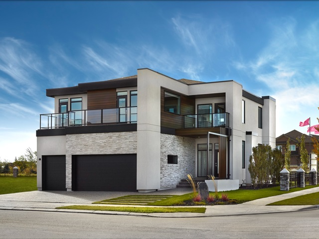 WELCOME to 4103 Cameron Heights Pointe. This NATIONAL AWARD WINNING contemporary 2-storey home by Vicky's Homes is nothing less than a master piece! The Vittorio sits at 3494 sqft with a fully open concept main floor plan. This home is truly a entertainers dream featuring a 15 person U-shaped island, high-end WOLF appliances, a fully functional coffee and wine bar, and all the storage you could ever need, including a camouflaged pantry. The fully finished basement features a theatre room, space for a gym, a rec room with a fully functional wet bar as well as a bedroom and full bathroom. The main floor features 2'x3' porcelain tiles with hydronic heating throughout as well as a half bath and den. The second floor features a spa like master ensuite, a huge walk in closet, and laundry. The kids rooms both have walk in closets, ensuite, and balcony's! Also on the second level is a bonus room with a tech station and balcony access. Lastly it features an oversized triple garage and back deck off the kitchen!