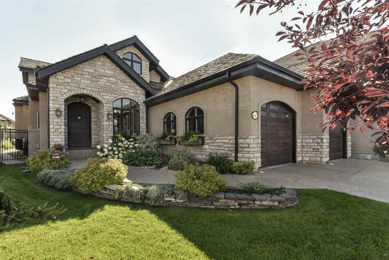 Luxury & quality are evident throughout this custom built 2,266 sq.ft. bungalow located on a quiet cul-de-sac in MacTaggart.  The living room features vaulted ceilings, hardwood floors, gas stone-facing f/p with mantle, built-in shelves & plenty of windows to allow natural light in. The spectacular kitchen has custom cabinets, large island/breakfast bar w/granite counter tops & is open to the breakfast nook w/garden door leading to manicured yard. Retreat to the spacious master bedroom w/gas f/p, B/I shelve, walk-in closets & spa like 4-piece ensuite. A formal dining room, laundry room & addt?l bedroom compliment the main floor w/9ft. ceilings, the lower level is bright & open with games room, family room, wet bar & 2 bedrooms. Designed w/Executive in mind, the spacious upper level loft has den/office & overlooks the living room. Central air, in-floor heat, hardwood, top of the line S/S appliances, U/G sprinkler, are a few of the luxuries this beautiful home has to offer.